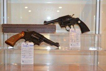 A Smith & Wesson pistol and a Colt pistol for sale at Shawsheen Firearms & Gunsmithing in Billerica, MA