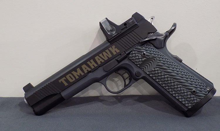 A tomahawk pistol advertising gun repair in Billerica, MA